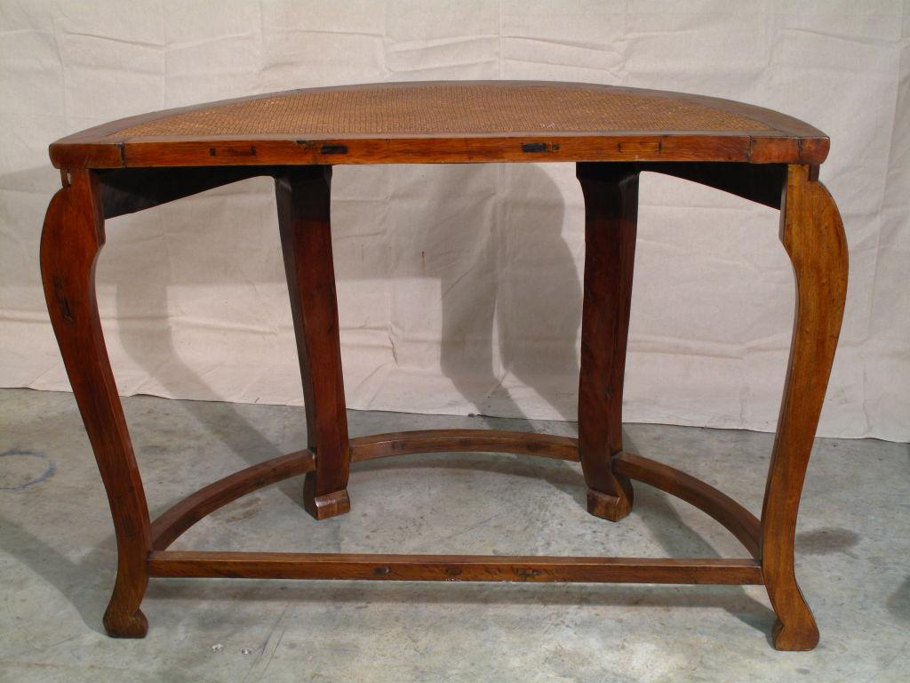 A Simple And Elegant Chinese Demilune Table In Elmwood. Slight Cabriole  Legs Extend From A