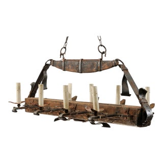 "French Mid-Century Wooden Beam and Iron ""Belted"" Gentleman's Chandelier For Sale"