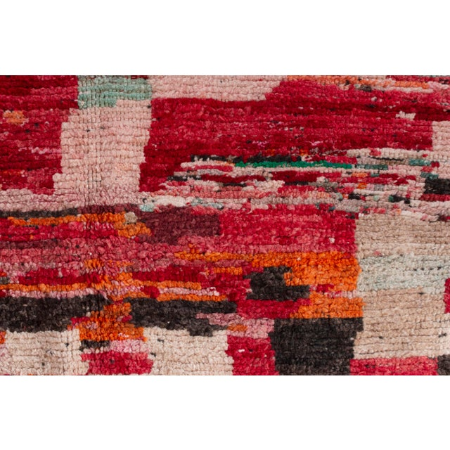 Hand knotted Berber Moroccan wool rug. Thick pile. Vibrant colors. Fabulous statement piece!