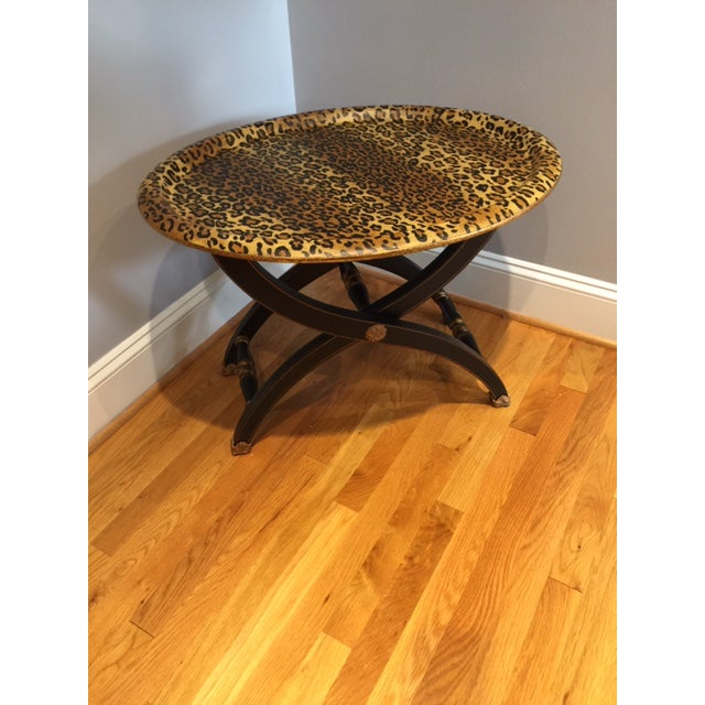 We love this vintage Sarreid coffee table! It is unique and versatile. It makes a statement while maintaining a...