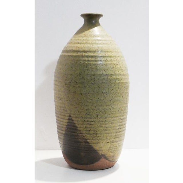 Studio Pottery with pattern made of different colored triangles. Warm tones finish off this beautiful piece. I was unable...