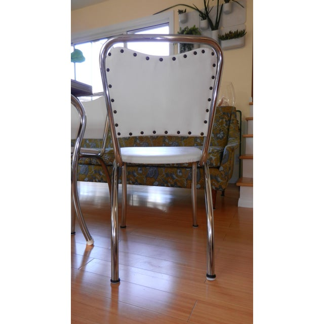 All original Lloyd Manufacturing Dinette Table Set with Four Chairs with Lloyd Mfg. label Chairs are white vinyl with...