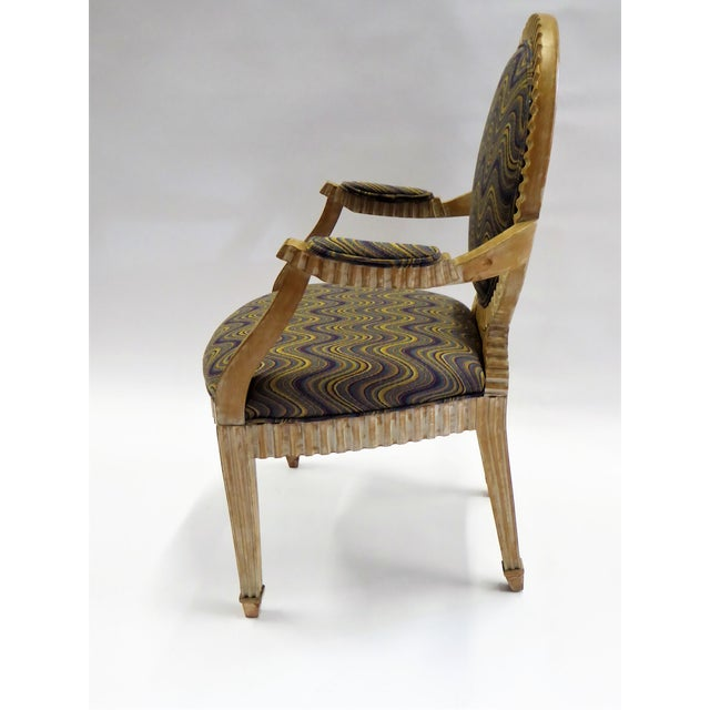 This fluted and cerused armchair inspired by a Louis XIV chair is magnificent. This creation took inspiration from John...