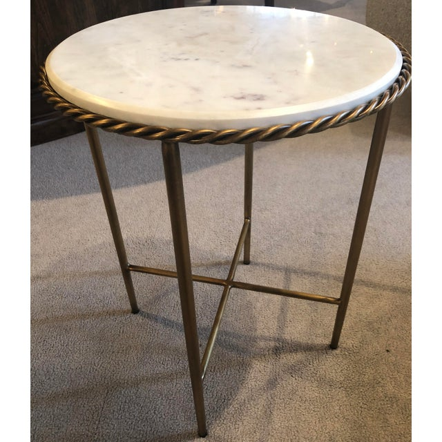 iron, antique brass finish on base - marble, white top