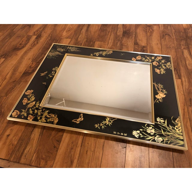 La Barge reverse painted gilded wall mirror with ribbed gold frame. The mirror is beveled, the surrounding border has a...