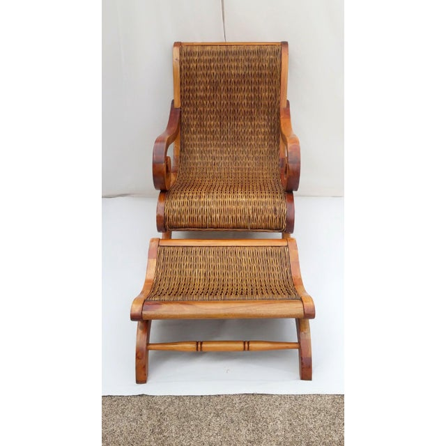 Vintage West Indies British Colonial Style Plantation Chair. Made from teak and handwoven cane. This beautiful chair and...