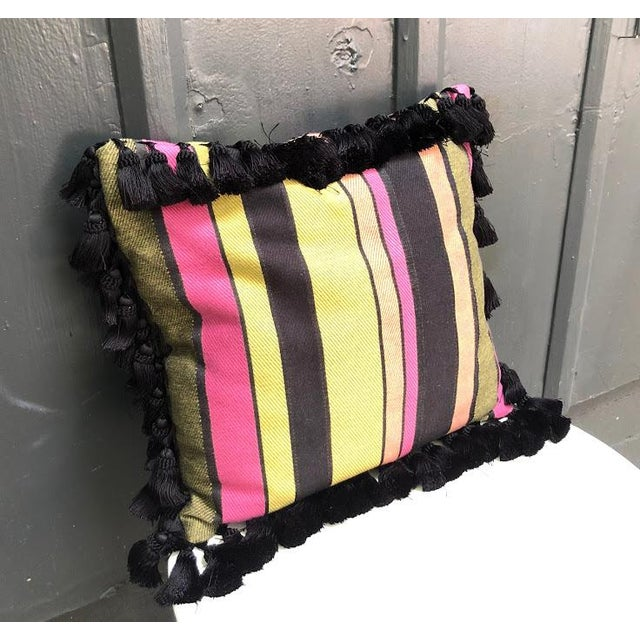 """Black/multicolored striped throw pillow with tassel border. Excellent condition. Measures 16"""" x 17"""" not including tassels."""