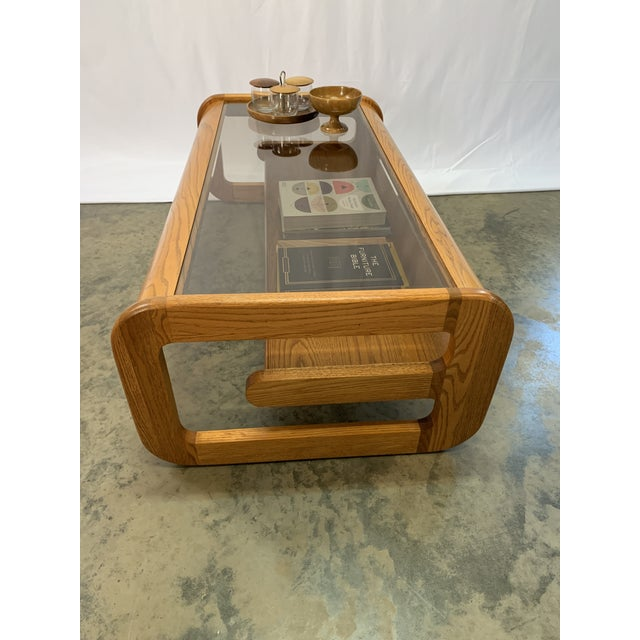 A beautiful California design Mid-Century Modern Lou Hodges oak coffee table. Table has an inset smoked grey glass top...
