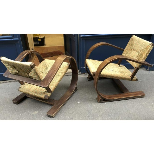 Audoux Minet pair of bent wood lounge chair with a rare rush cover.