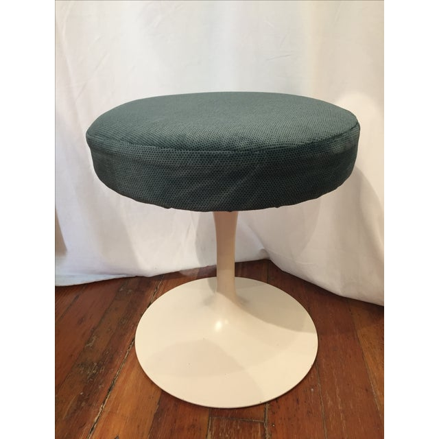 Offered is an original vintage Knoll International stool. This elegant piece features a green seat with a white tulip base.