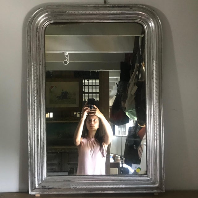 Beautiful antique silver gilt Louis Philippe French mirror with banded etching on the edges and original wood back. Lovely...