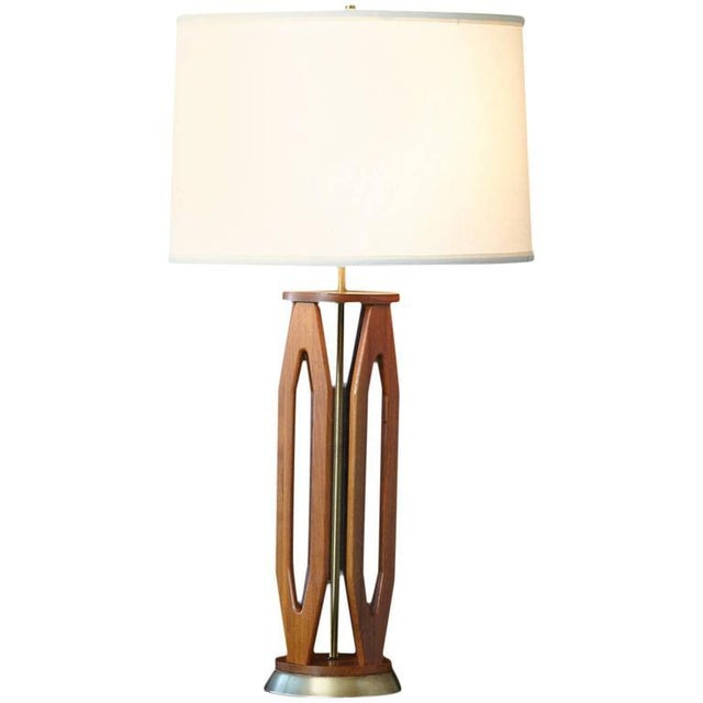 """Geometrically sculpted teak table lamp with brass base. Very nice graphic shape. Height to finial 34""""."""