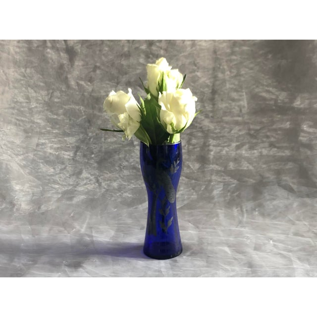 This lovely vintage Art Deco era Czechoslovakia-made cobalt blue glass vase has a sterling silver peacock bird overlay....