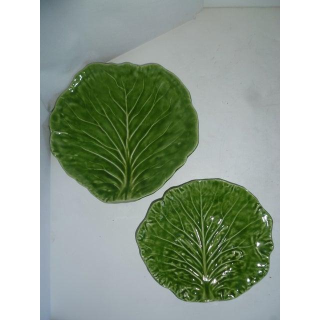 Pair of handcrafted 1970s-80s Barbara Eigen green cabbage leaf majolica plates with veins in relief. Barbara Eigen has...