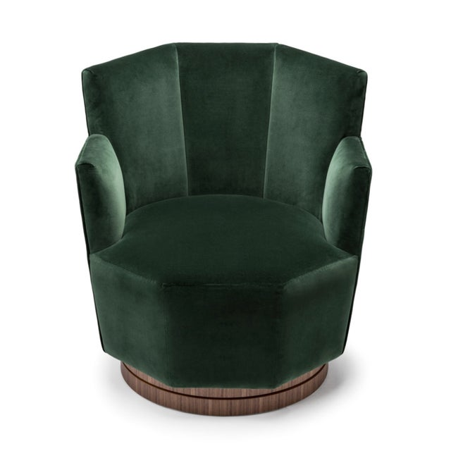"""Amy Somerville's Quinaquina swivel chair features a softly blooming octagonal shape and is finished in """"Smoking Room..."""