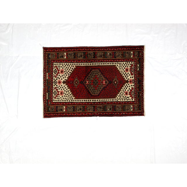 Wool pile hand woven vintage Persian Hamadan rug in excellent condition.
