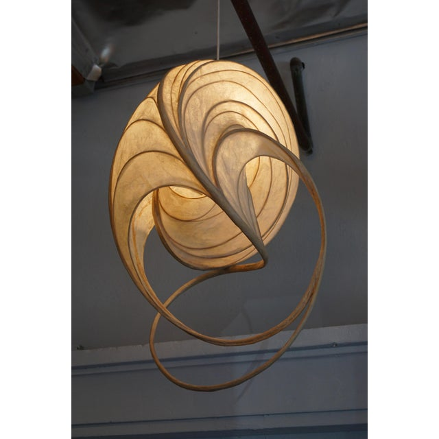 Leslie makes these one of a kind hanging light sculptures out of bentwood and a fiber resin that emulates Japanese rice...