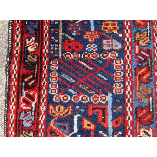 Handmade antique Persian Heriz rug in red wool. The rug is from the beginning of 20th century in original condition, it...