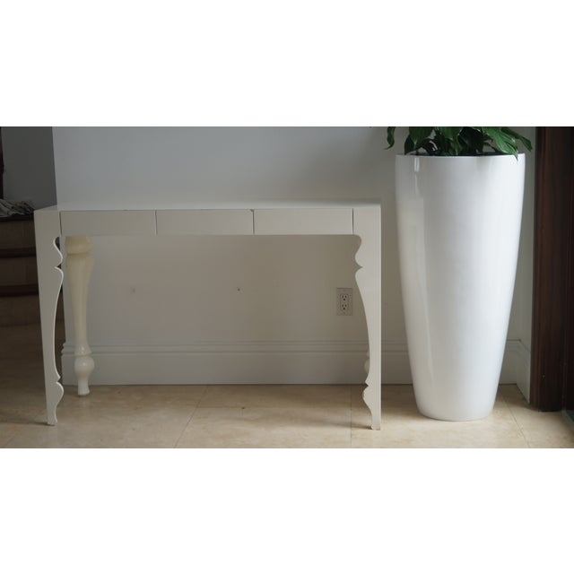 Award winning John Reeves Design console table. A rare and unique console table. The legs and sleek timeless design...