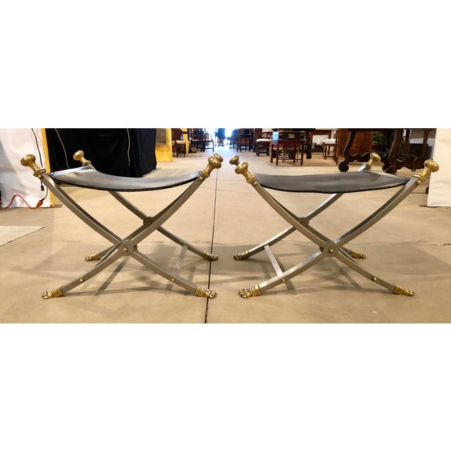 Jansen style stools/benches brushed nickel over steel frames with brass paw feet and finials. Stamped Italy on underside...