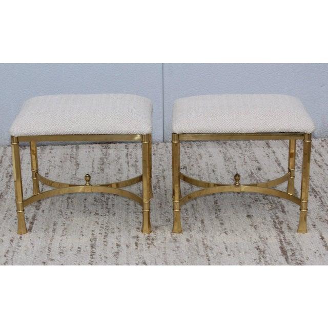 1970s modern Italian brass ottomans. Newly upholstered.