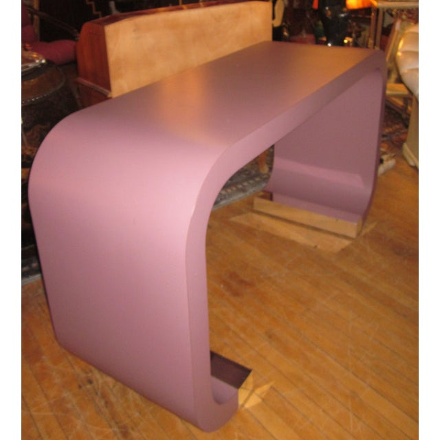 This is a fabulous vintage 1980s-1990s art deco revival postmodern style waterfall curved line console table, in the style...