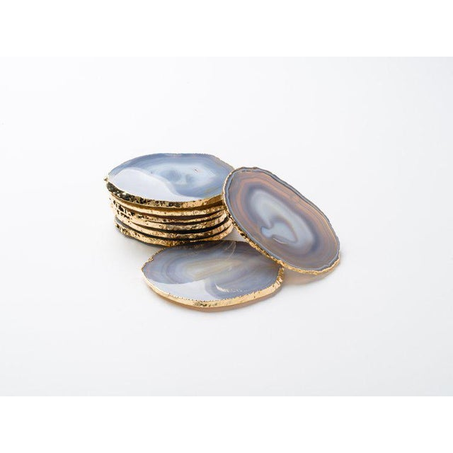 Stunning natural agate and crystal coasters with 24-karat gold plated edges. Three color variations are available: Teal,...