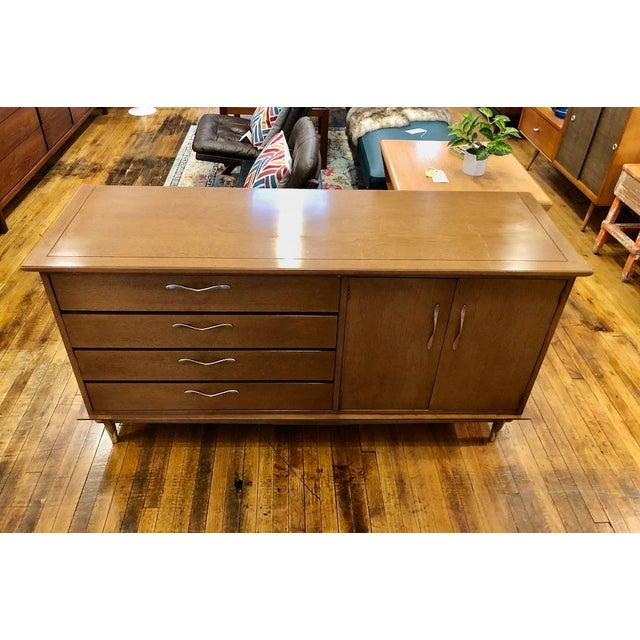 Lane Copenhagen Credenza in a lighter-toned Walnut. Great storage. Adjustable shelf inside the right cabinet, 4 drawers on...