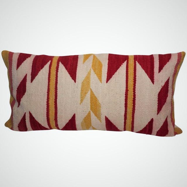This large Navajo weaving pillow contains vibrant red and yellow colors with an unusual geometric pattern. The condition...