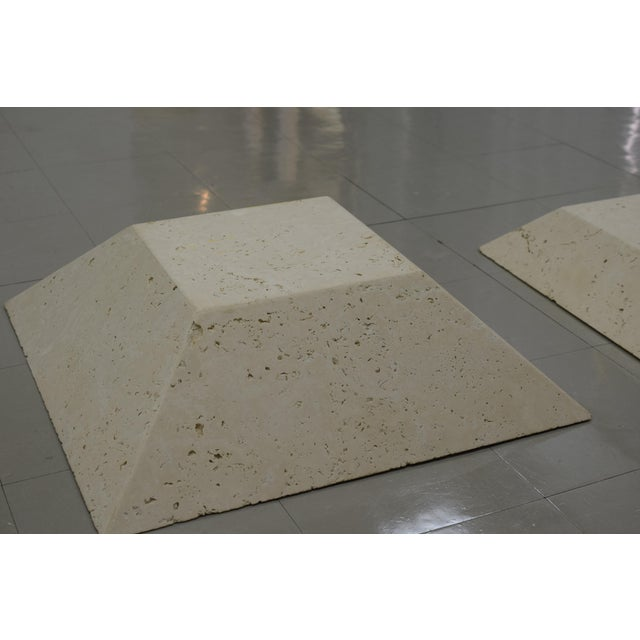 Modern bases for sculpture made out of unfilled travertine. Pyramid shape and low to the ground. H: 6 3/4 W: 27 x L: 27...
