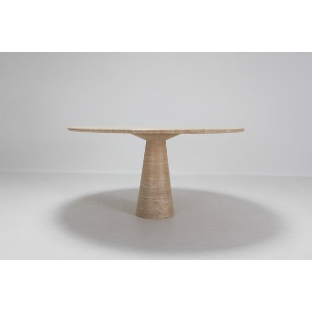 Postmodern minimalist dining table in travertine marble by Angelo Mangiarotti. The T cone shaped base plays visually well...