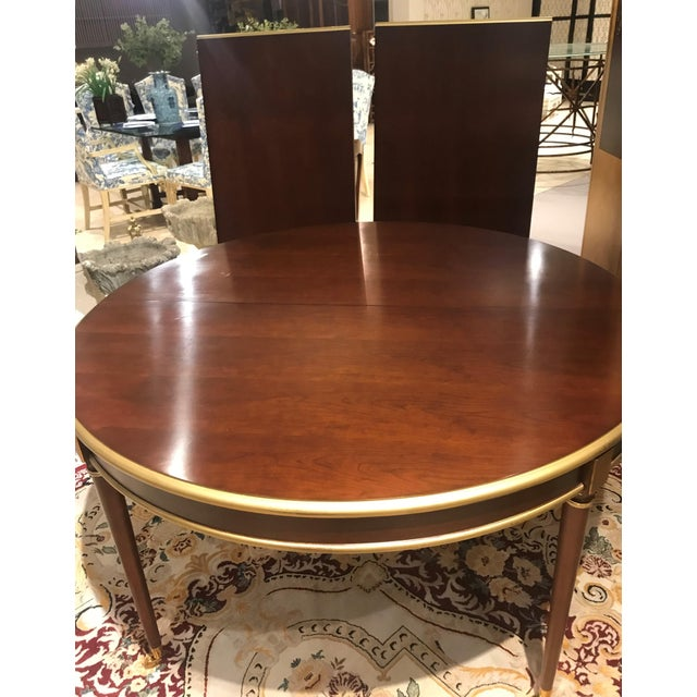 """Round walnut Hickory Chair dining table designed by Suzanne Kasler. Includes two 24"""" leaves to expand to a 102"""" oval. """"The..."""