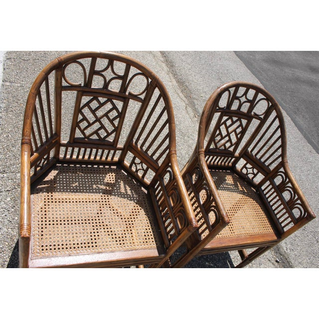 Exotic set of chinoiserie bent bamboo chairs. Bamboo is absolutely beautiful and in great vintage condition. Chairs are...