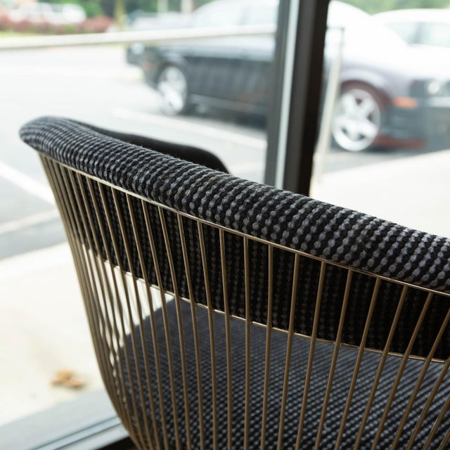 Newly reupholstered in a black wool fabric that plays off the linear design of Platner's iconic chair.