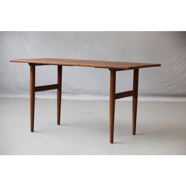 Beautiful rosewood coffee or side table designed by Kurt Østervig for Jason Møbler Danmark, circa 1960s. Stamped on the...