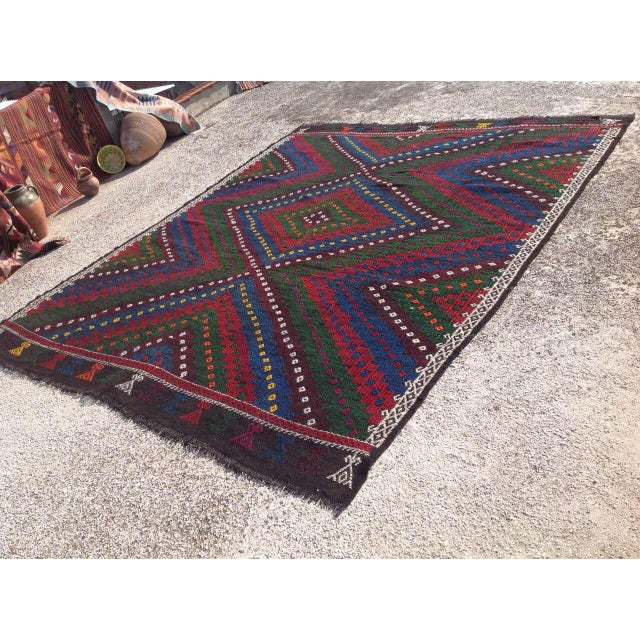 This beautiful, vintage, handwoven kilim is approximately 60 years old. It is handmade of goat wool in all natural colors....