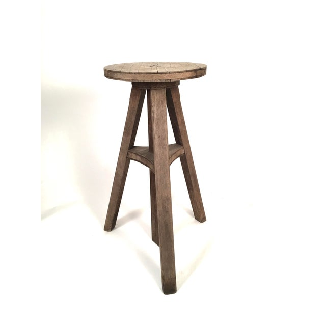 A hard to find sculptor's stand in oak, circa 1900, the circular rotating platform over an adjustable height support on 3...