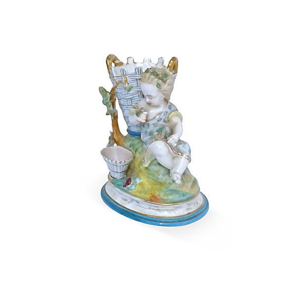 Antique; 19th century, French, majolica, porcelain, cherub figurine vase depicting a small cherub child in a garden...