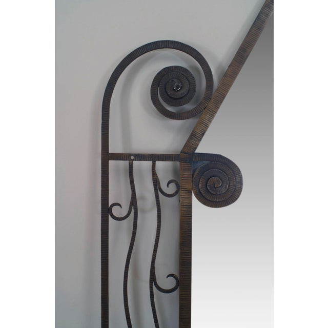 French Art Deco large iron rectangular shaped mirror with scroll corners and wavy design border