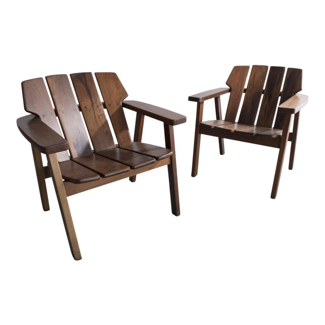 Pair of slatted rosewood lounge chairs by Sergio Rodrigues, Brazil, 1960s. For Sale