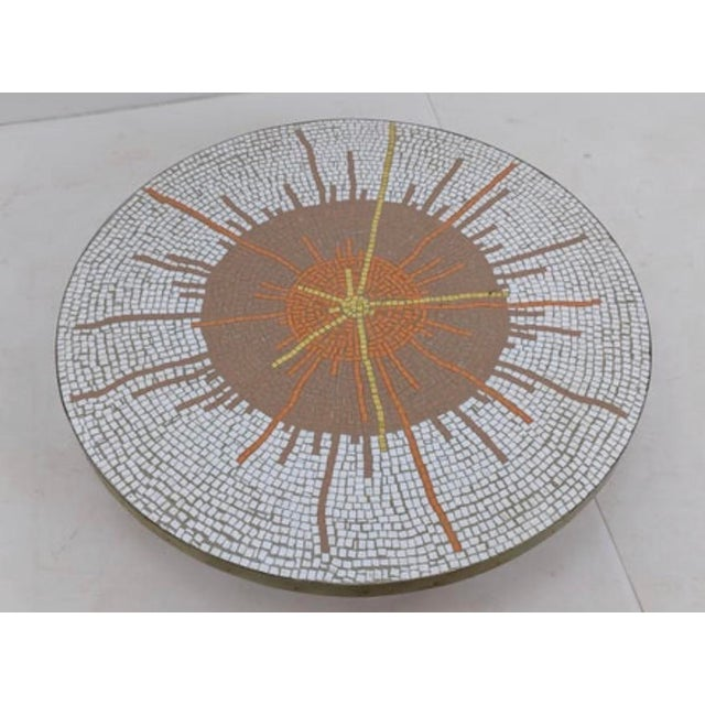 Probber style mid century mosaic table with modernist sunburst design. Brass band trim. Tapered walnut legs.