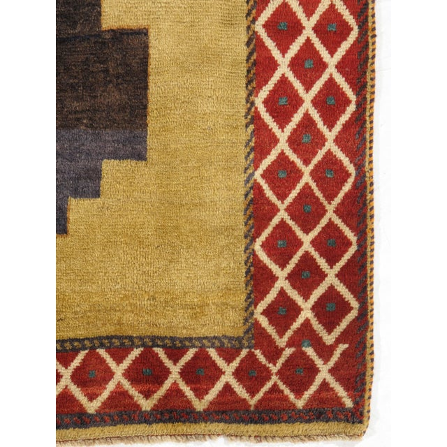 Vintage hand-knotted Persian Gabbeh rug with an unique design in multi-colors. This rug has very soft pile, natural colors...