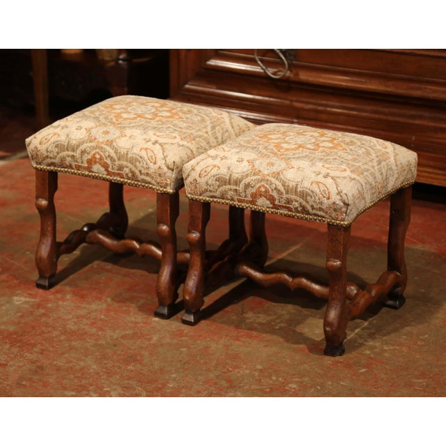 These elegant antique stools were crafted in Southern France, circa 1880. The fruitwood pieces feature fine, hand-carved...