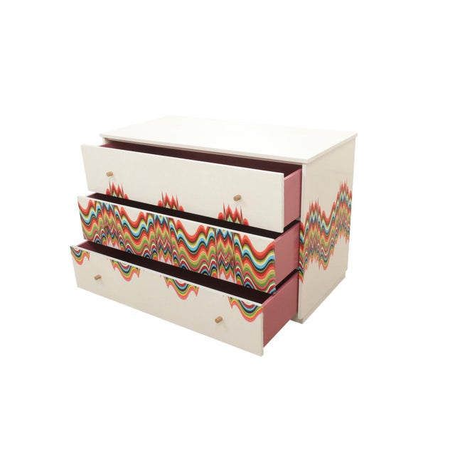 """Mid century dresser wrapped in technicolor """"poured"""" fabric. The entire case is wrapped in high end designer fabric in a..."""