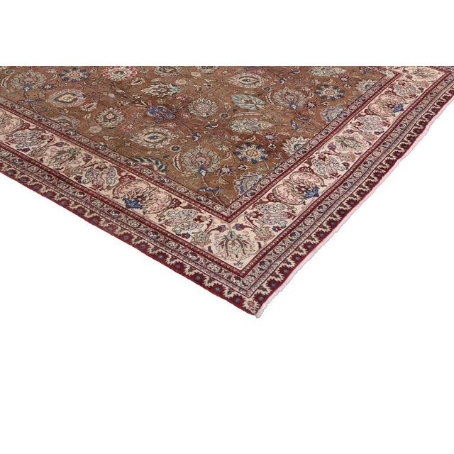 This luxurious vintage Persian Tabriz Gallery rug features an arabesque Art Nouveau style and refined colors. With its...