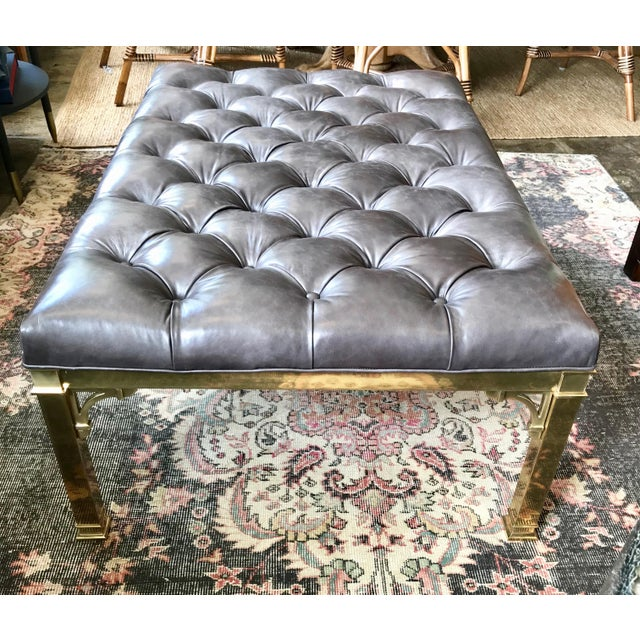 This is an absolutely gorgeous vintage brass base with a new tufted leather top. This custom made coffee table is the...