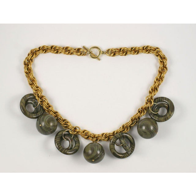"""Large chunky goldtone chain with multiple grey tiger striped baubles. Balls are 1"""" in diameter. Due to the unique nature..."""