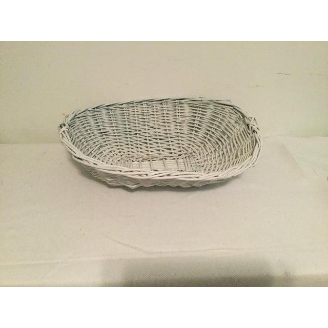 "Decorative basket, 19 1/2"" long, 14 1/2"" wide, 5"" deep."
