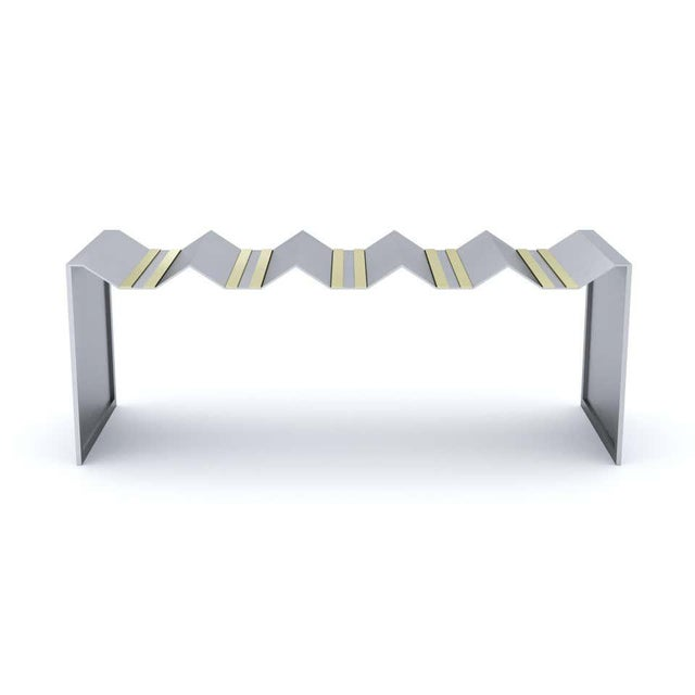 Futuristic bench. Stainless steel 12Ga. Brush finish. Brass 260. Handcrafted stainless-steel decorative bench. It has...