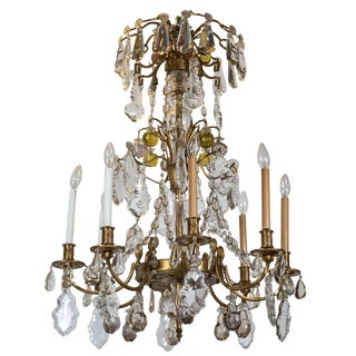 A Finely Cast Bronze and Crystal Eight Arm Chandelier For Sale